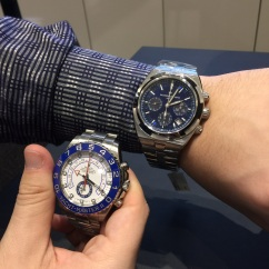 Vacheron Constantin Overseas Chronograph in Stainless Steel (42.5mm) next to a Rolex Yacht-Master II in Stainless Steel (44mm) for size comparison.